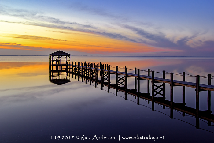 Dock in Duck, NC reflecting on a calm evening.