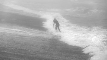 Skimboarder on a Foggy Winter Day at Kitty Hawk Pier